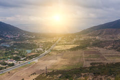 Mountain town with road and lake Royalty Free Stock Photography