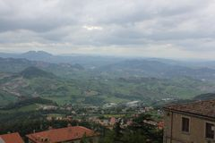 Mountain town somewhere in Italy. With views of the mountains and rooftops in cloudy weather stock photos