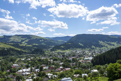 Mountain town under blue sky. View from height Stock Photos