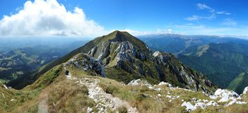 Mountain track on the edge of Piatra Craiului mts. Royalty Free Stock Photo