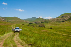 Mountain Track. A 4x4 vehicle navigates a mountain 4x4 track near the Sterkfontein dam outside of Harrismith South Africa royalty free stock photo