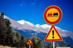 Mountain traffic signs. Traffic signs on a mountain road royalty free stock photography