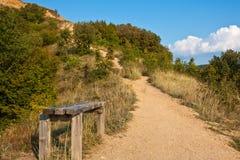 Mountain Trail. Bench on a trail in Rila Mountains, Bulgaria Royalty Free Stock Image