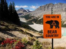 Bear Country, Canadian Rockies, Canada. Mountain trail in Bear Country with warning sign. Canadian Rockies, Alberta. Canada royalty free stock image