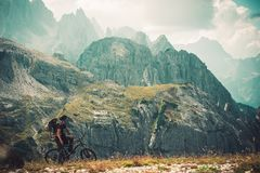 Mountain Trail Bike Trip. Caucasian Sportsman in His 30s on His Performance Bike in the Italian Dolomites. Auronzo Di Cadore, Italy Stock Photography
