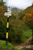 Mountain trail direction sign. Sign on a hiking trail in Piatra Craiului mountains, in a late autumn day Stock Images
