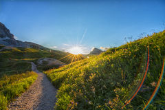 Mountain trail in Dolomites at sunset,  Veneto, Italy Royalty Free Stock Photography