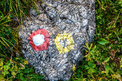 Mountain trail marker on a stone or a rock. Royalty Free Stock Photography