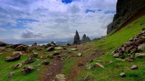 Mountain trail in the mountains Old Man of Storr, Scotland stock footage