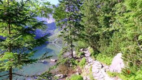 Mountain trail near lake in the middle of the Tatras mountains at dawn, Poland stock footage