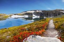 Mountain Trail Spring Landscape, Glacier Lake stock photo