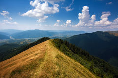 Mountain trail on top of hills on sky background Royalty Free Stock Photo