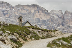 Mountain trail in the Tre Cime di Lavaredo, Italy. The Tre Cime di Lavaredo are three of the most famous peaks of the Alps in the Sexten Dolomites of Stock Photos