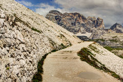 Mountain trail in the Tre Cime di Lavaredo, Italy. The Tre Cime di Lavaredo are three of the most famous peaks of the Alps in the Sexten Dolomites of Stock Photography
