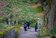 Mountain trail in Yamadera, Japan. Yamadera, Japan - Dec 5, 2016. People walking on trail at sacred forest in Yamadera, Japan. Yamadera is a scenic temple Stock Image