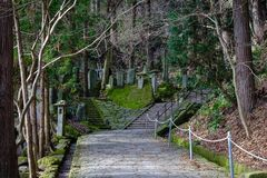 Mountain trail in Yamadera, Japan. Walking trail at sacred forest in Yamadera, Japan. Yamadera is a scenic temple located in the mountains northeast of Yamagata Stock Image