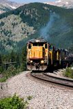 Mountain Train 2. A diesel locomotive high in the Colorado Rockies Royalty Free Stock Photo
