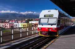 Mountain train arriving in Poprad railway station. With Tatry in the background royalty free stock images