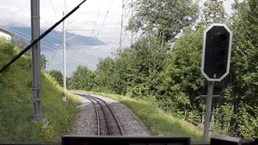 Mountain Train Railroad. Green Swiss train moving in the mountains stock footage