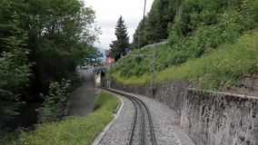 Mountain Train Railroad. Green Swiss train moving in the mountains stock video