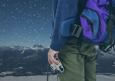 mountain travel, bag and camera at night with stars Stock Images