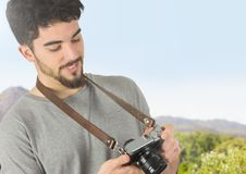 Mountain travel, with the camera, looking the photos Stock Photography