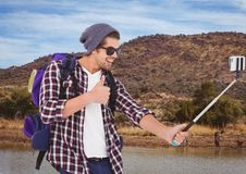 mountain travel, happy boy doing selfie with animals stock images