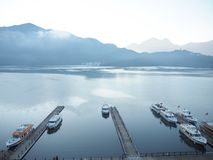 Early morning at the Sun moon lake, Taiwan. Mountain, travel, holiday, weekend, tour, tourism, relax, romance, beautiful, nature, boats, puer, view, landscapes stock photo