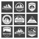 Mountain travel, outdoor adventures logo set. Hiking and climbing labels or icons for tourism organizations, events Stock Images