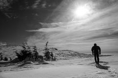 Mountain Traveler in winter time. Black and white Stock Image