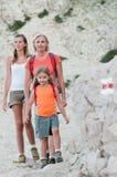 Mountain trek. Family trekking on red trail Stock Images