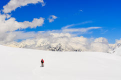 Mountain trekker walking in high winter Himalayas mountains Stock Photos