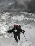 Mountain trekking. (Hiker in mountains Stock Photos