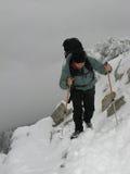 Mountain trekking. (Hiker in mountains Stock Photo