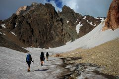 Mountain trekking. Group of mountaineers hiking in high Pamirs Royalty Free Stock Images