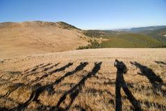 Mountain trekking. Some tourists on a mountain trek Royalty Free Stock Photography