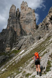 Mountain trekking. Tourist with backpack in mountain scenery Royalty Free Stock Photos