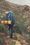 Mountain trekking man Stock Photo
