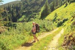Mountain trekking trip woman Stock Images