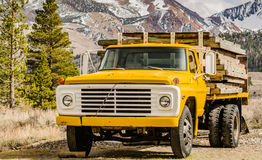 Mountain Truck. Yellow pickup truck delivers wood slats in Mammoth Lakes, California Stock Photos