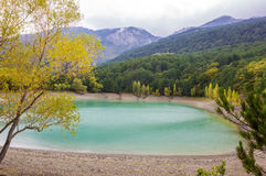 Mountain turquoise lake and cloudy day Royalty Free Stock Images