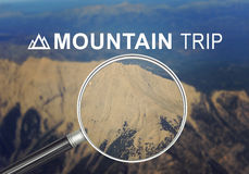 Mountain under magnifier Royalty Free Stock Photography