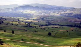 Mountain valley. Green mountain valley and village Royalty Free Stock Photo