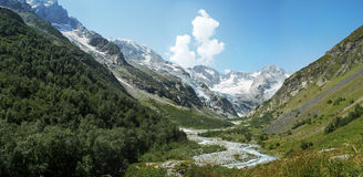 Mountain valley. North Caucasus high mountain valley on a daylight and a mountain river stock photo