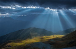Mountain valley in beams of evening sun. Caucasus mountains. Stock Images