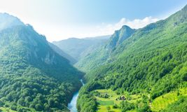 Mountain valley with beautiful blue sky stock photography
