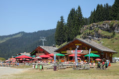 A mountain valley with cafes for rest in hot summer day Royalty Free Stock Image