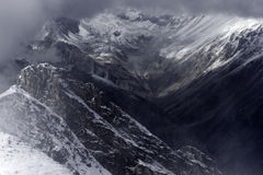 Mountain valley Caucasus. Aerial view on a mountain valley in the Caucasus region Russia. Valley is covered by snow and surrounded by clouds Royalty Free Stock Photography