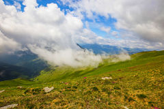 Mountain valley with clouds touching the hill , beautiful scenic Royalty Free Stock Photo