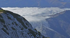 Mountain valley covered by fog. Piatra Craiului Mountains Stock Images